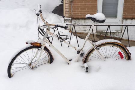 Bike covered with fresh snow in Montreal during snow storm in 2016