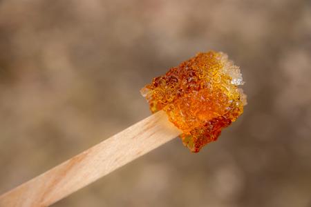taffy: Maple taffy on a stick during sugar shack period