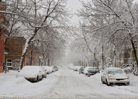 ice storm: The street filled with fresh snow during a snow storm Stock Photo
