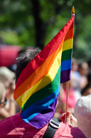 gay pride: Man holding a gay rainbow flag Stock Photo