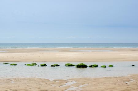 calais: Zen picture of a beach with aligned rocks near Calais, Pas-de-Calais, France Stock Photo