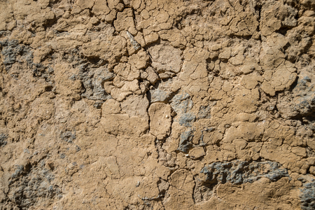 mud wall: Cracked Mud Wall in the Himalayan region, Nepal Stock Photo