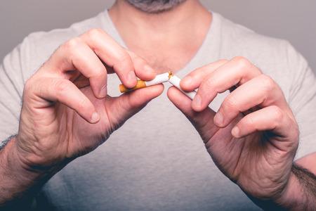 crushing: Quitting smoking - male hand crushing cigarette