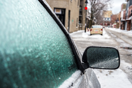 iciness: Montreal, CA, 29th February 2016. Car mirror and windows are covered with ice after freezing rain. Editorial