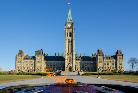 centennial: Parliament building in Ottawa, Canada  - Centre Block, Peace Tower and Centennial Flame Stock Photo