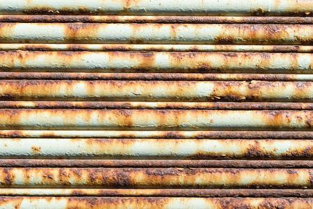 Beige and orange rusty garage door