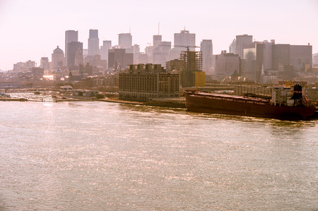Montreal skyline from Jacques Cartier Bridge, with warm backlight, during golden hour. Banco de Imagens