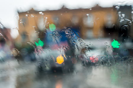 windscreen: Blurred picture of traffic through a car windscreen during heavy rain.