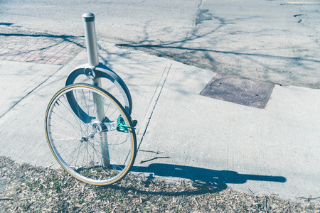 Bike theft with locked wheel in Ottawa, Canada (vintage filter)