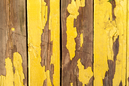 Old weathered yellow wooden wall Stockfoto