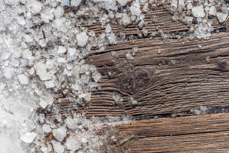 shattered: Pieces of shattered ice on a wood surface