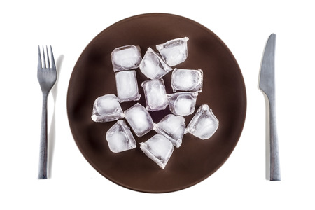 anorexia: Concept picture of a plate with ice cubes, symbolizing Anorexia Stock Photo