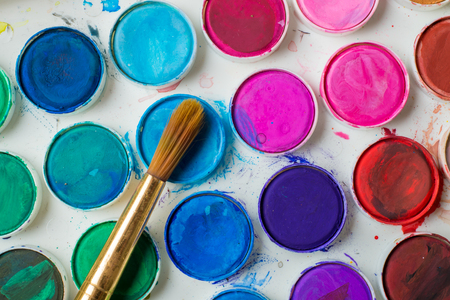 paintbox: Close-up of water-color paint-box and paint brush. Stock Photo