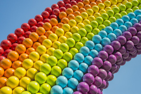 Detail of a rainbow made of balls, showing gay colors