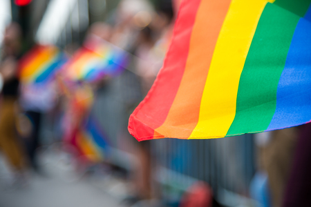 Blurred picture of a gay rainbow flag at a pride parade