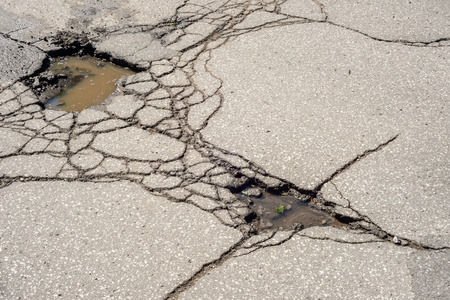 Large deep pothole in Montreal street, Canada.