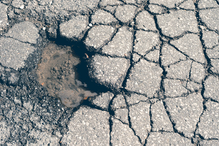 pot hole: Large deep pothole with faded effect in Montreal street, Canada. Stock Photo