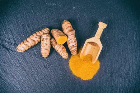 Turmeric roots and powder with faded filter