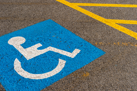 disabled blue parking sign painted on dark asphalt in Canada Stockfoto
