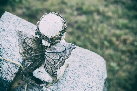 Back view of an angel statue in a cemetary with faded effect Stock Photo