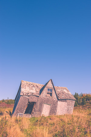 crooked leaning old house with vintage filter