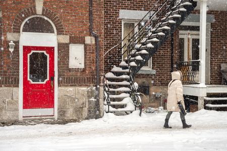 Snowstorm in Montreal. Pedestrian walking on a sidewalk. Stock Photo