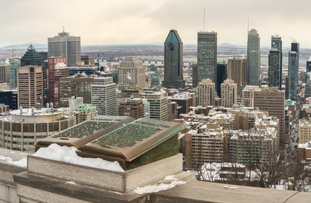 Montreal Skyline in winter and Commemorative Jacques Cartier plaque located on the balustrade of the Kondiaronk lookout on Mount Royal