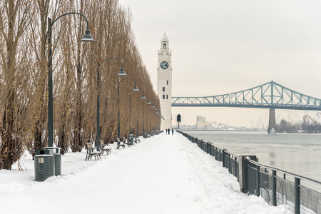 St. Lawrence River with Clock tower in Old Montreal, in winter.