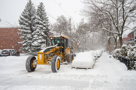 marquette: Montreal, CA - 19 December 2016: A snowplow in motion on Marquette Street during snow storm.