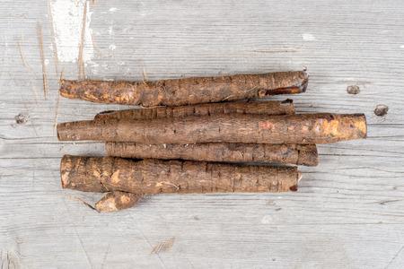 Group of black raw salsifies on wood