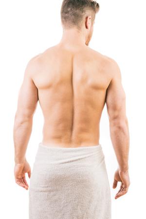 タオルを巻いて筋肉青年の背面図 写真素材