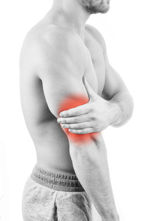 Man with shoulder pain over white background
