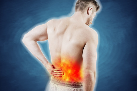 Concept picture of a man with lower back pain