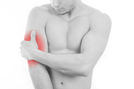 Man with triceps pain over white background
