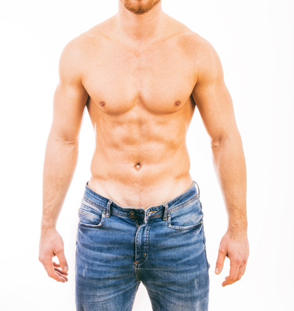 sixpack: Muscular young man wearing jeans Isolated on white background.