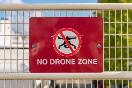 No drone zone sign on a fence