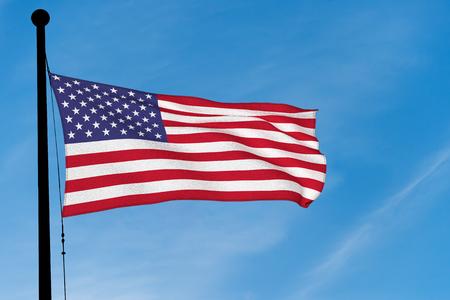 US Flag waving over blue sky (digitally generated image)
