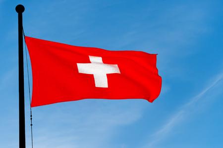 Swiss Flag waving over blue sky (3D rendering)