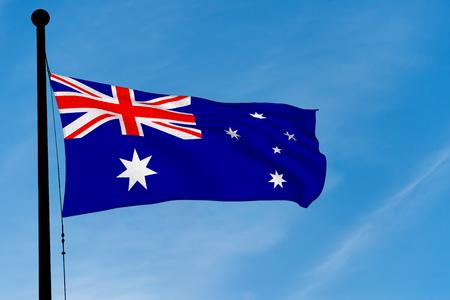 Australian Flag waving over blue sky (3D rendering)