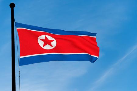 North Korean Flag waving over blue sky (3D rendering)