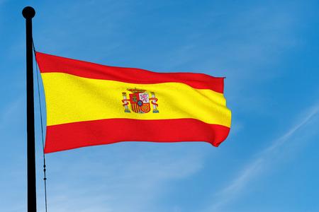 Spanish Flag waving over blue sky (3D rendering) Banco de Imagens