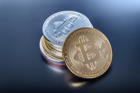 Stacked Bitcoin cryptocurrency coins Stock Photo