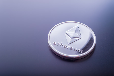 Ethereum (ETH) cryptocurrency real coin. Reklamní fotografie