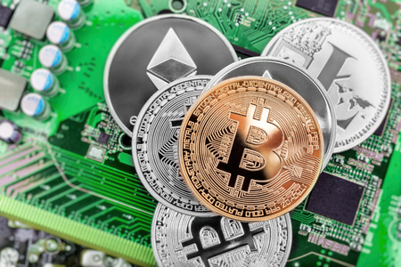 Circuit board and cryptocurrency coins (Bitcoin, Ethereum and Litecoin)