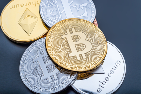 Stacked cryptocurrency coins (Bitcoin, Ethereum, Litecoin) Stock Photo