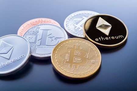 Stacked cryptocurrency coins (Bitcoin, Ethereum, Litecoin) Reklamní fotografie