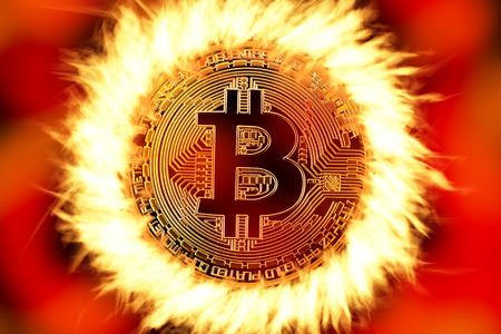 Bitcoin cryptocurrency golden coin on fire Reklamní fotografie