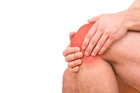 Man with knee pain over white background