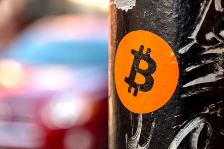 Bitcoin sticker on a street sign post Stock Photo
