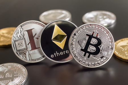 Montreal, CA - 28 May 2018:  Bitcoin, Ethereum and Litecoin crypto currency metallic coins